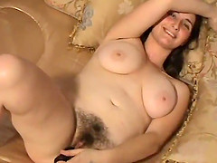 Brunette masturbates nicely toying her hairy pussy and gets nailed doggystyle
