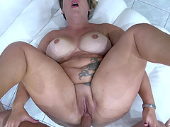 Buxom short haired mature blonde Aisha Bahadur gets her pussy pounded