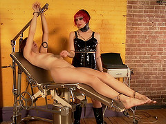 Mature MILF lesbian abuses her slave girl with toys
