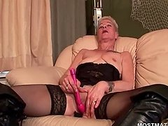 Nasty blonde mature satisfying her cunt with sex toys