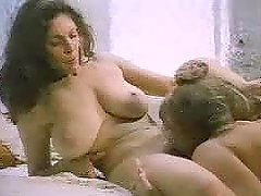 Mature blonde seduces a cute brunette and makes lesbian love with her