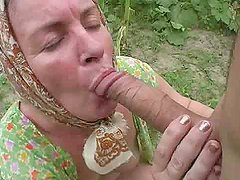 Lewd granny gets her ass pounded in the corn field