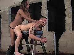 Slim Black tranny in police uniform fucks a guy