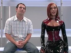 Gorgeous redhead tranny in latex suit bangs her slave