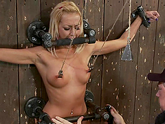 Slim Breanne Benson gets tied up to a wall and toyed