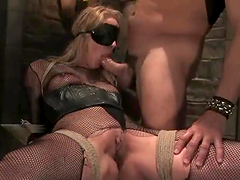 Hot blonde in fishnet bodysuit gets bounded and fucked