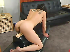 Busty brunette Alexa spreads her legs for a machine