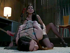 Mistress with a fine ass is fucking her slave in bondage