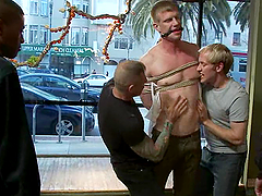 Handsome gay enjoys a gangbang and gets facialed in public