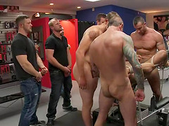 A gay gets humiliated and fucked in public in bondage clip
