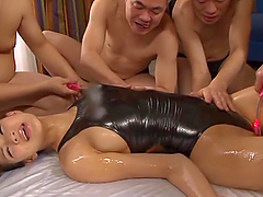 Oiled up Minami Aoi sucks dicks and gets pounded rough