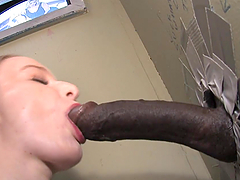 Yummy Kandi Hart Slurps A Big Black Cock In A Gloryhole
