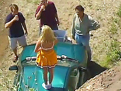 Admirable cheerleader in a gangbang being drilled on a car outdoor