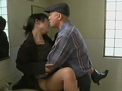 Pleasant Asian cowgirl giving blowjob in public toilet