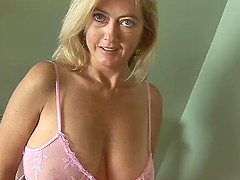 A mature amateur on her knees getting jizz on her face and tits