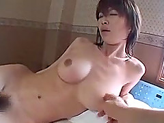 Bosomy Japanese chick blows and gets her pussy banged