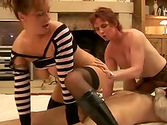 Mature bitch and her blond GF share a weiner in homemade FFM clip