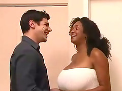 Curvy ebony tart plays with her tits and gets fucked doggy style