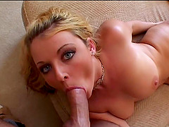 A big blonde sucking, licking and playing with a big dick