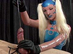 Perverted blonde in blue latex outfit does dirty stuff to guy's cock