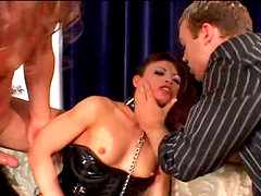 Latex-clad brunette with a hairy pussy enjoying a hardcore threesome