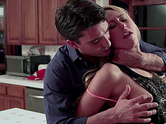 A blonde babe with a hair pussy gets fucked on a kitchen counter