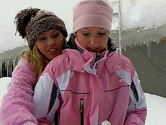 Lesbian chicks warming up by having sex outdoors in the snow