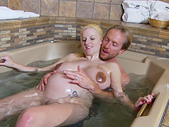 Pregnant blonde with huge tits fucked in the hot tub