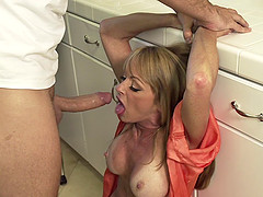Insatiable blonde MILF gets face fucked by a younger guy