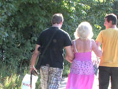 Granny and a couple of college guys have a threesome in the woods
