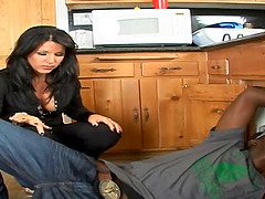 Black-haired housewife having the interracial session in the kitchen