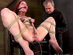 Curvy slave in bondage having her pussy inserted with toys in BDSM
