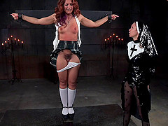 This mature redhead has been very naughty and the nun will punish her!