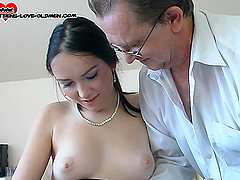 Shaved pussy brunette in thong loves licking huge balls