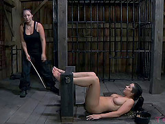 Hot Beverly Hills licks a twat and deepthroats a toy in the dungeon