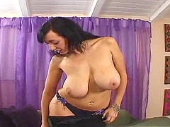Seductive harlot with massive tits rides on a long cock