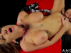 Angelina with fake tits licking her lesbian babe pussy