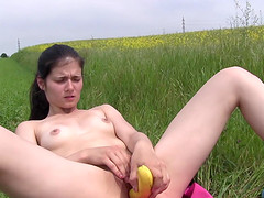 Food fetish Lexy screwing pussy using banana outdoor