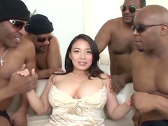 Busty Mako Oda attacked by a bunch of nasty black lovers
