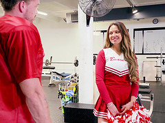 Cheerleader Brooke Beretta in uniform uses her body and fucks in the gym