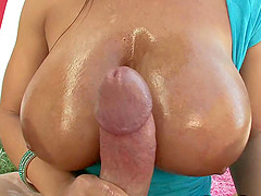 Lisa Ann makes a cock hard with her oiled up tits before sex