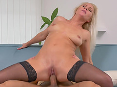 Gorgeous blonde MILF Kathy Anderson fucked doggy style in stockings