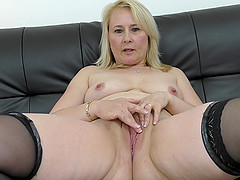 Solo mature blonde model Michelle masturbates with toys on the couch