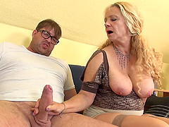 Mature blonde granny Beate A. strips and sucks cock