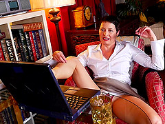 Short haired mature business woman Kali plays with her feet and pussy