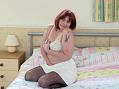 Redhead mature amateur Jade pounds her pussy until she cums