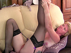 Mature blonde amateur MILF Sarah H. pounds her pussy with a dildo
