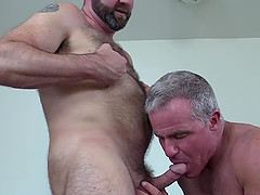 Topher Phoenix takes on mature and muscled Dale Savage for a one-on-one