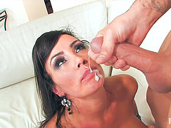 MILF Lisa Ann's face is covered in sperm after she takes care of him