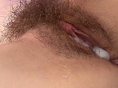 Brunette Japanese MILF sucks cock and gets her hairy pussy cream pied
